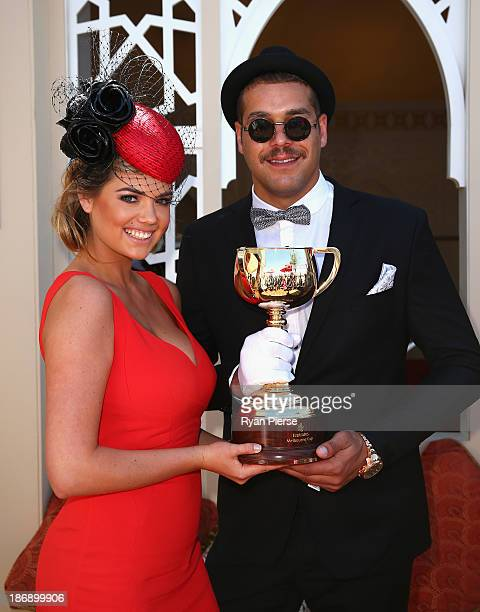 Kate Upton and Lance Franklin pose with the Melbourne Cup during Melbourne Cup Day at Flemington Racecourse on November 5 2013 in Melbourne Australia