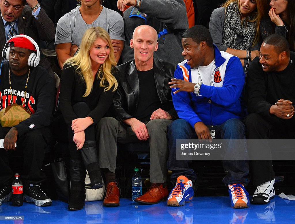 Kate Upton, guest and Tracy Morgan attend the Houston Rockets vs New York Knicks game at Madison Square Garden on December 17, 2012 in New York City.