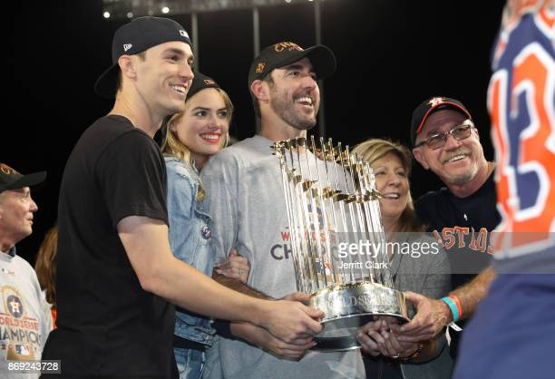 Kate Upton poses for a photo with boyrfriend Justin Verlander of the Houston Astros holding the The Commissioner's Trophy after the conclusion of The...