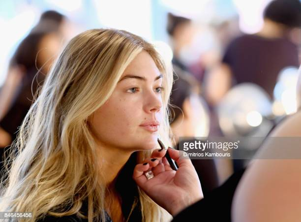 Kate Upton prepares backstage at Michael Kors Collection Spring 2018 Runway Show at Spring Studios on September 13 2017 in New York City