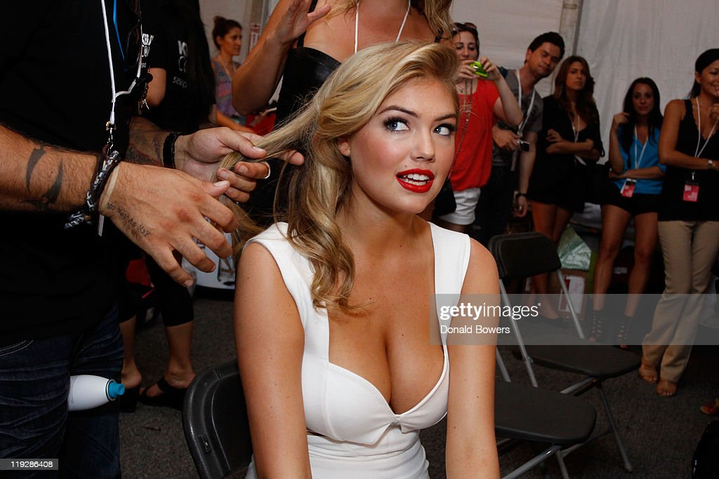 Kate Upton prepares backstage at the Beach Bunny Swimwear show during Mercedes-Benz Fashion Week Swim 2012 at The Raleigh on July 15, 2011 in Miami Beach, Florida.