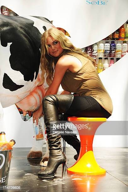 Kate Upton Sports Illustrated Swimsuit 2011 Rookie of the year tries milking a fake cow filled with Sobe Orange Cream at the SoBe Try Everything...
