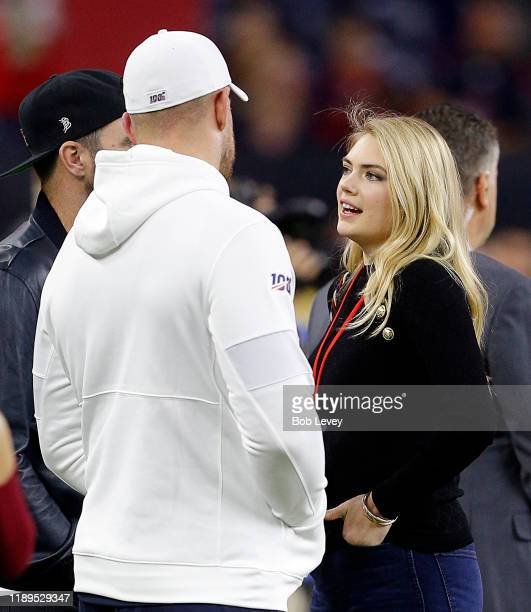 Kate Upton talks with her husband Justin Verlander and JJ Watt of the Houston Texans at NRG Stadium on November 21 2019 in Houston TexasThe Houston...