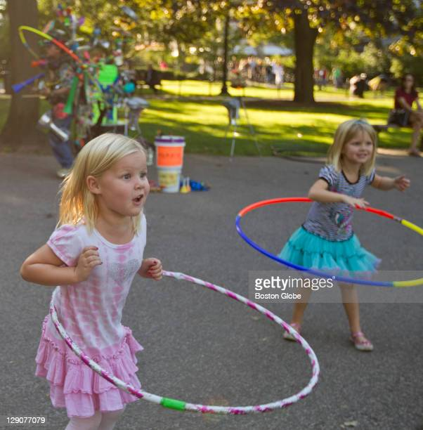 Kate Vercruse and her twin sister Audrey Vercruse of Los Angeles Calif doing the Hula Hoop the the music of Ramblin' Dan of Cambridge a oneman band...