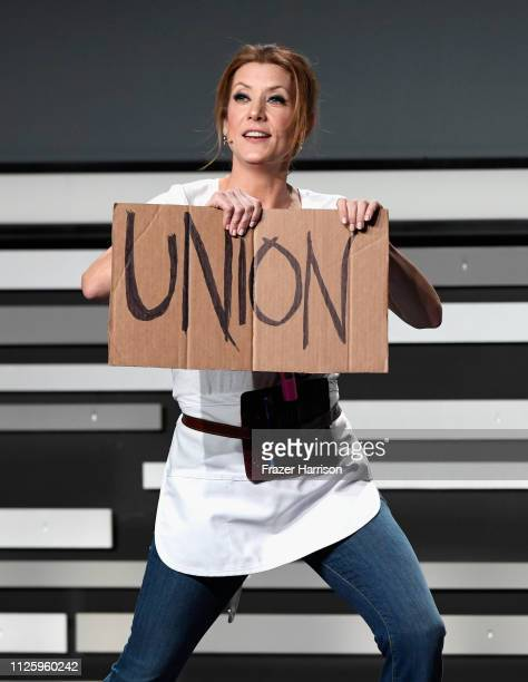 Kate Walsh holds a sign that reads 'UNION' onstage during The 21st CDGA at The Beverly Hilton Hotel on February 19 2019 in Beverly Hills California