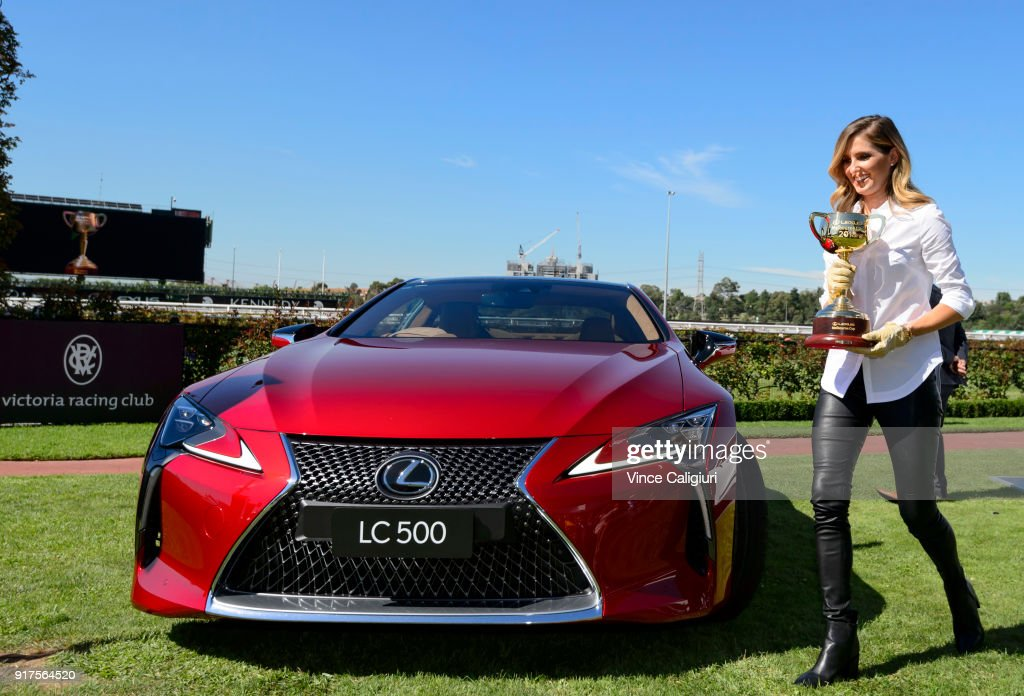 Kate Waterhouse is seen holding the 2018 Melbourne Cup after driving the Lexus LC 500 during the VRC Melbourne Cup Sponsorship Announcement at Flemington Racecourse on February 13, 2018 in Melbourne, Australia. The VRC announced global luxury lifestyle brand Lexus as the new Melbourne Cup Principal Partner at Flemington Racecourse.