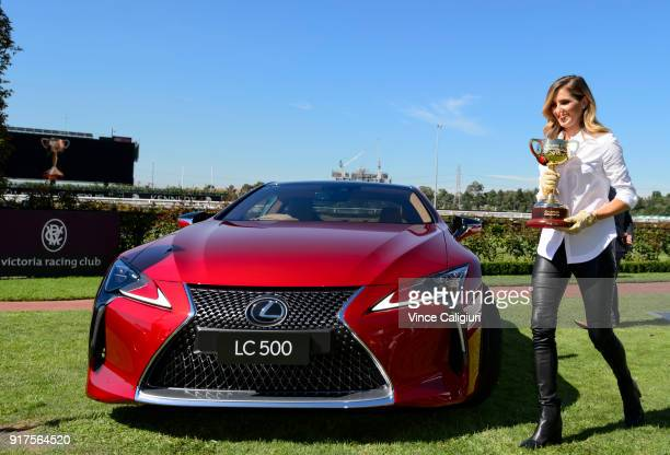 Kate Waterhouse is seen holding the 2018 Melbourne Cup after driving the Lexus LC 500 during the VRC Melbourne Cup Sponsorship Announcement at...