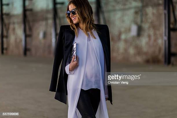 Kate Waterhouse wearing black Preen sunglasses, a black Balmain blazer, white long Rosetta Getty coat, Belinda shirt, black Lxe pants and silver...