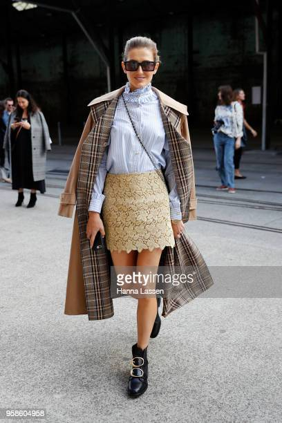 Kate Waterhouse wearing Macgraw top and skirt and Gucci trench coat during MercedesBenz Fashion Week Resort 19 Collections at Carriageworks on May 15...