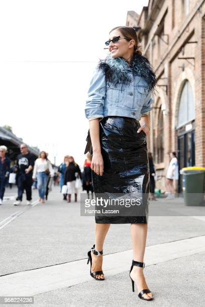 Kate Waterhouse wearing Prada denim jacket and Poppy Lissiman sunglasses during Mercedes-Benz Fashion Week Resort 19 Collections at Carriageworks on...