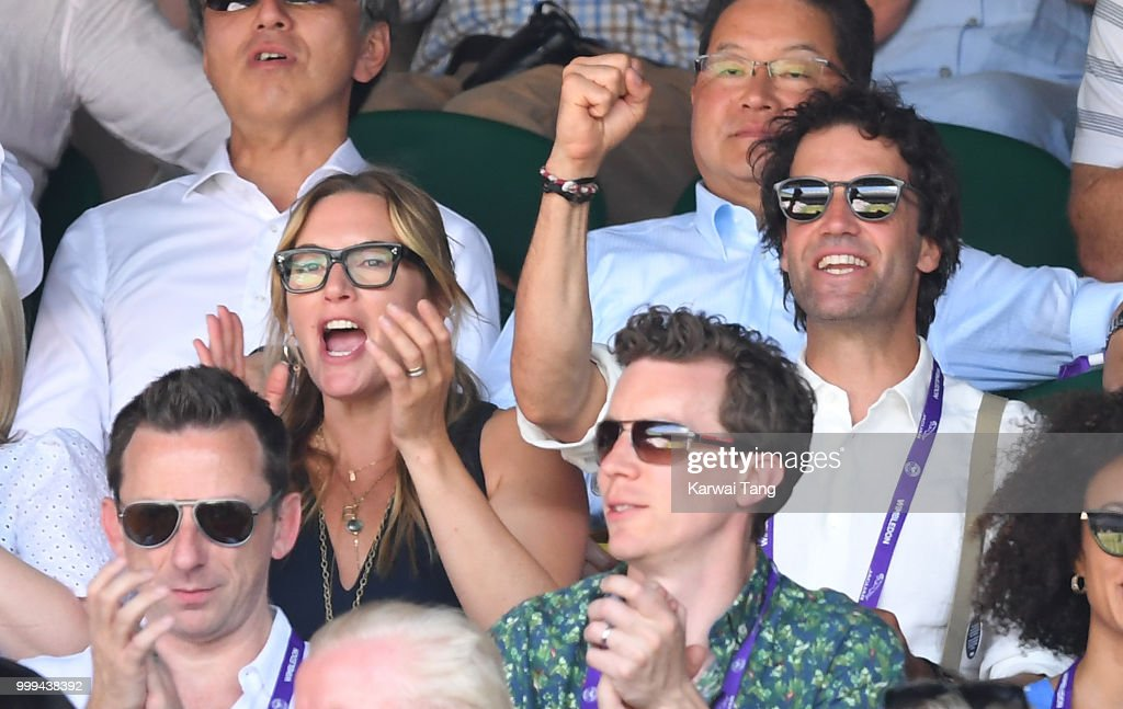 Kate Winslet and Ned Rocknroll react during the men's singles final on day thirteen of the Wimbledon Tennis Championships at the All England Lawn Tennis and Croquet Club on July 15, 2018 in London, England.