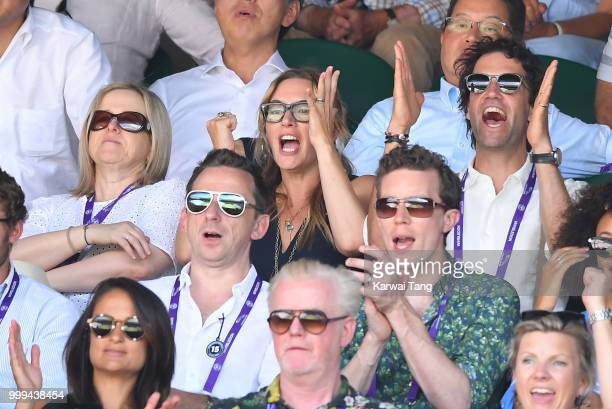 Kate Winslet and Ned Rocknroll react during the men's singles final on day thirteen of the Wimbledon Tennis Championships at the All England Lawn...