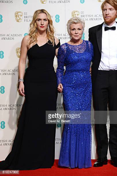 Kate Winslet, Julie Walters and Domhnall Gleeson pose in the winners room at the EE British Academy Film Awards at The Royal Opera House on February...