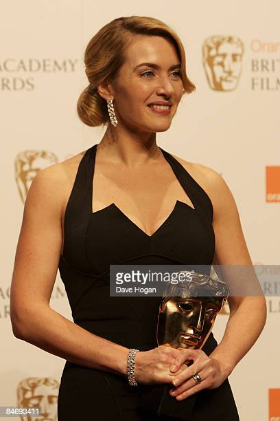 Kate winslet poses with her 'Leading Actress' BAFTA in the press room at The Orange British Academy Film Awards held at the Royal Opera House, Covent...