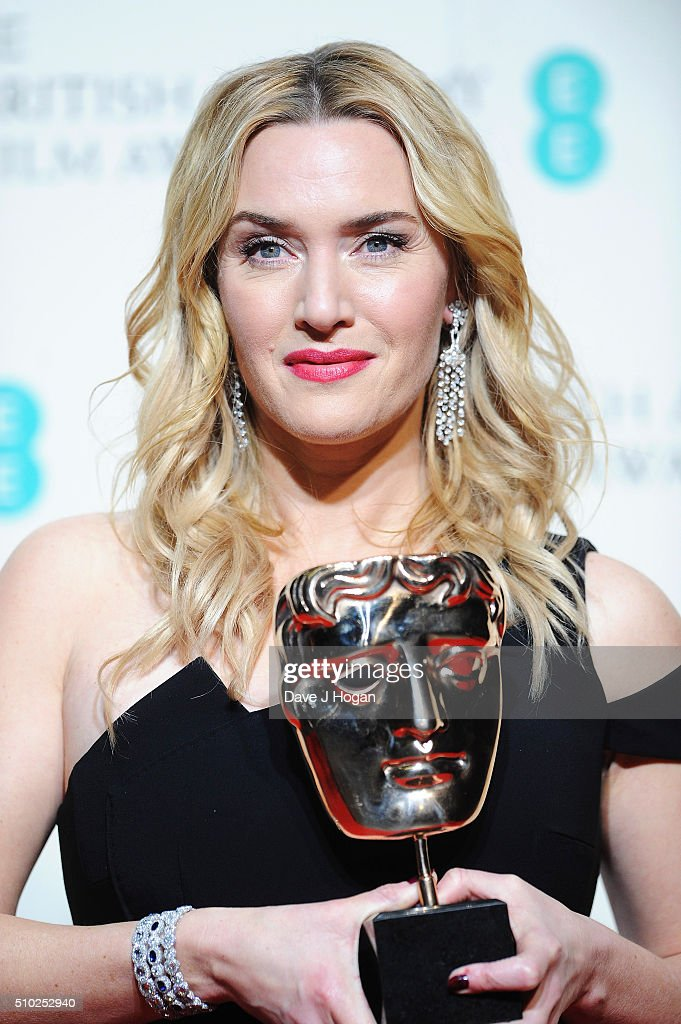 Kate Winslet poses with the award for Supporting Actress for 'Steve Jobs' in the winners room at the EE British Academy Film Awards at The Royal Opera House on February 14, 2016 in London, England.