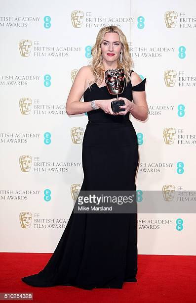 Kate Winslet poses with the award for Supporting Actress for 'Steve Jobs' in the winners room at the EE British Academy Film Awards at The Royal...