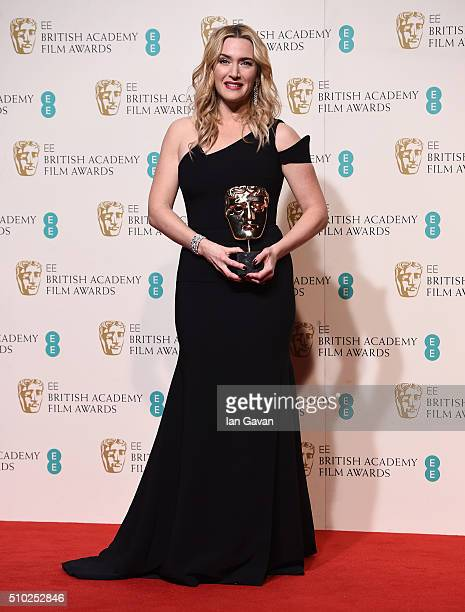 Kate Winslet poses with the Best Supporting Actress Award for 'Steve Jobs' in the winners room at the EE British Academy Film Awards at the Royal...