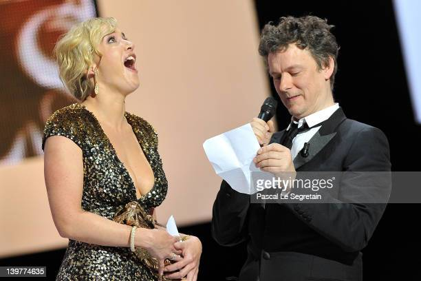 Kate Winslet reacts as Michel Gondry awards her with the Cesar of Honour during the 37th Cesar Film Awards at Theatre du Chatelet on February 24 2012...