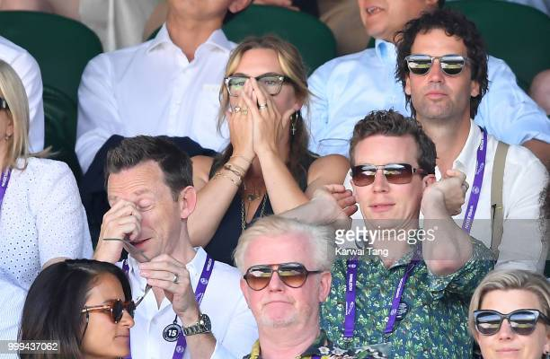 Kate Winslet reacts as Ned Rocknroll looks on during the men's singles final on day thirteen of the Wimbledon Tennis Championships at the All England...