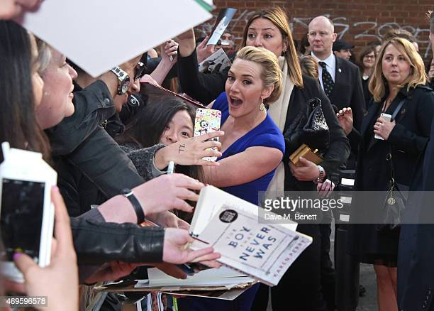 """Kate Winslet signs autographs at the UK premiere of """"A Little Chaos"""" at ODEON Kensington on April 13, 2015 in London, England."""