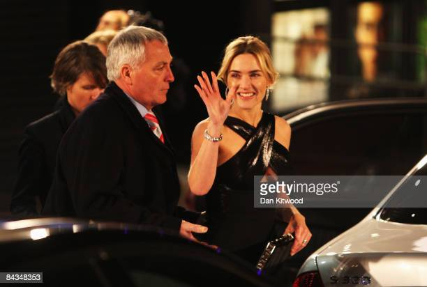 Kate Winslet waves as she leaves the European Film Premiere of 'Revolutionary Road' at the Odeon Leicester Square on January 18 2009 in London England