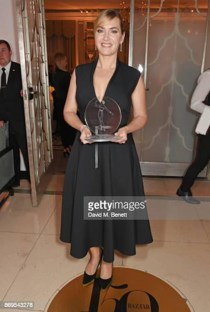 Kate Winslet winner of the British Actress of the Year award attends Harper's Bazaar Women of the Year Awards in association with Ralph Russo...