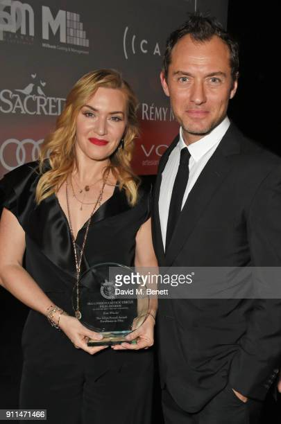 Kate Winslet winner of The Dilys Powell Award for Excellence in Film and presenter Jude Law attend the London Film Critics' Circle Awards 2018 at The...