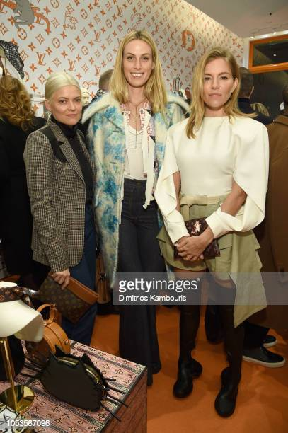 Kate Young Selby Drummond and Michelle Williams attend the Louis Vuitton X Grace Coddington Event on October 25 2018 in New York City