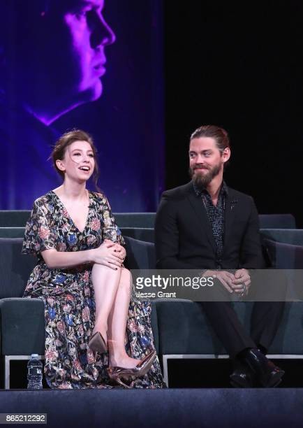 Katelyn Nacon and Tom Payne speak onstage at The Walking Dead 100th Episode Premiere and Party on October 22 2017 in Los Angeles California