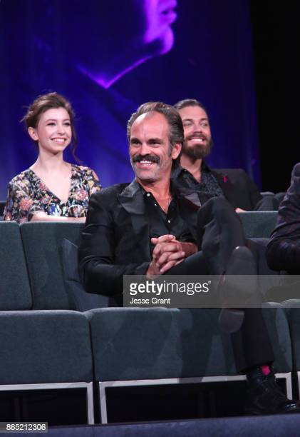 Katelyn Nacon Steven Ogg and Tom Payne speak onstage at The Walking Dead 100th Episode Premiere and Party on October 22 2017 in Los Angeles California