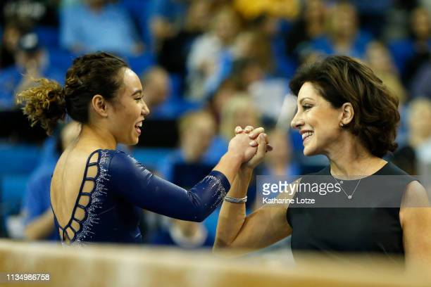 Katelyn Ohashi and coach Valorie Kondos-Field share a moment during a meet against Stanford at Pauley Pavilion on March 10, 2019 in Los Angeles,...