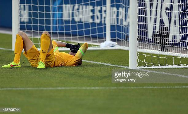Katelyn Rowland of the United States is upset after letting in the final goal in the shootout during the FIFA U20 Women's World Cup Canada 2014...
