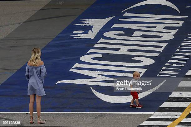 Katelyn Sweet and Owen Larson stand on the start/finish line after Kyle Larson driver of the Target Chevrolet won the NASCAR Sprint Cup Series Pure...
