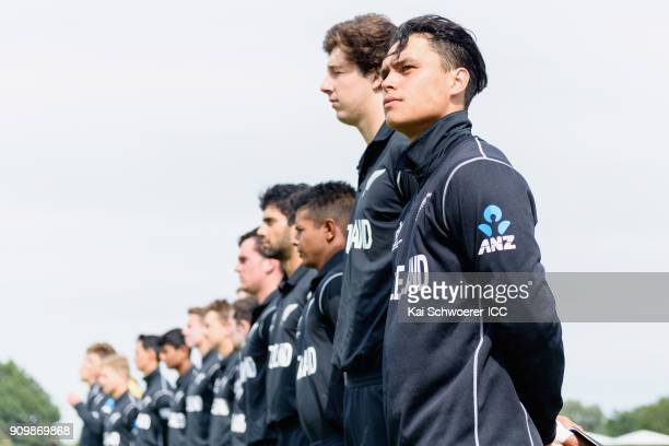 Katene Clarke of New Zealand and his team mates line up for their national anthem prior to the ICC U19 Cricket World Cup match between New Zealand...