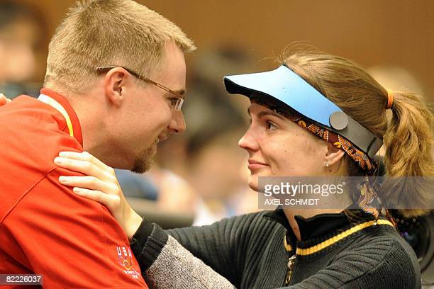Katerina Emmons of Czech Republic celebrates with her husband US shooter Matthew Emmons after winning gold in the women's 10m Air Rifle competition...