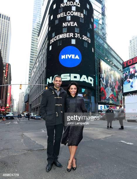 Katerina Graham and Cottrell Guidry ring the closing bell at NASDAQ MarketSite on December 31 2013 in New York City