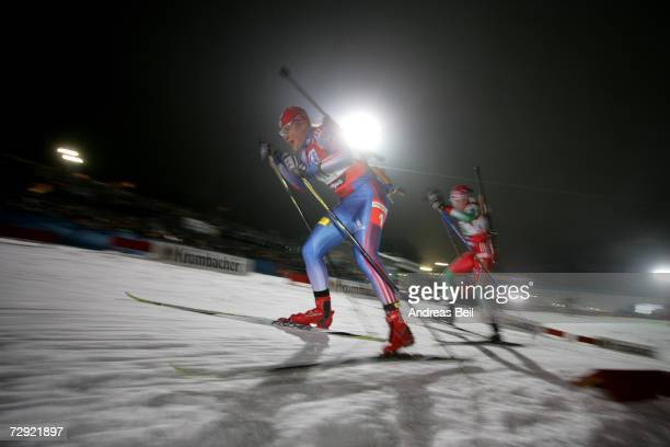 Katerina Iourieva of Russia overtakes Olga Kudrashov of Belarus in the womens 4x6 relay of the IBC World Cup on January 03, 2007 Oberhof, Germany