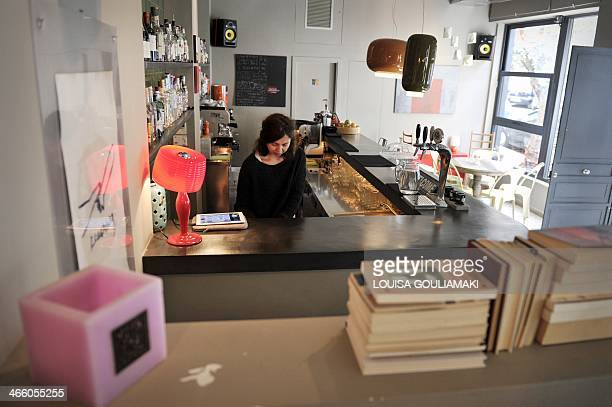 MAKRIS Katerina prepares a coffee at her newly opened caffeebar in Athens on January 29 2014 Katerina a 26year pharmaceutical sector veteran opened a...