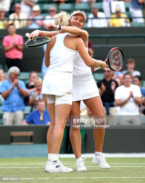 Katerina Siniakova and Barbora Krejcikova celebrate winning the Ladies' doubles final on day twelve of the Wimbledon Championships at the All England...