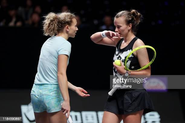Katerina Siniakova and Barbora Krejcikova of the Czech Republic discuss strategies against Samantha Stosur of Australia and Zhang Shuai of China...