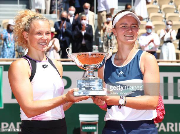 Katerina Siniakova and Barbora Krejcikova of The Czech Republic pose with the trophy after winning their Women's Doubles Final match against Bethanie...