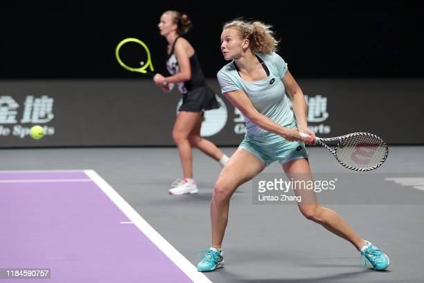 Katerina Siniakova and Barbora Krejcikova of the Czech Republic return the ball against Samantha Stosur of Australia and Zhang Shuai of China during...