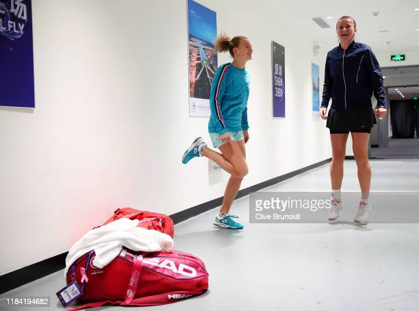 Katerina Siniakova and Barbora Krejcikova of the Czech Republic warm up in the tunnel prior to their Women's Doubles match against Su-Wei Hsieh of...