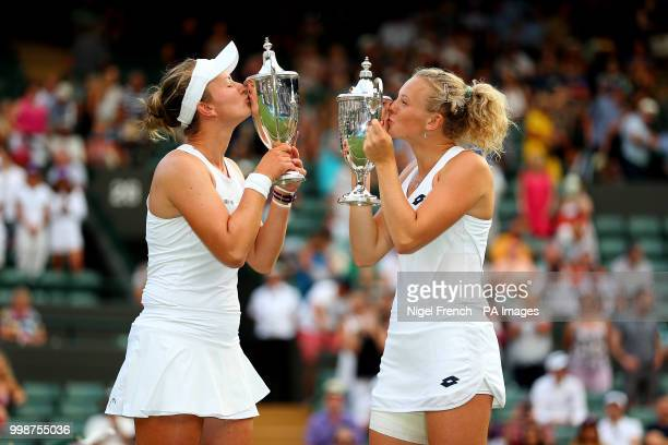Katerina Siniakova and Barbora Krejcikova with their trophies after winning the Ladies Doubles on day twelve of the Wimbledon Championships at the...