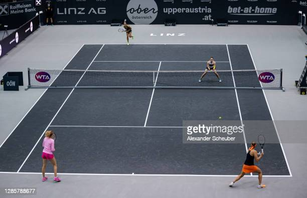 Katerina Siniakova and Lucie Hradecka of Czech Republic in action against Tamara Zidansek of Slovenia and Arantxa Rus of the Netherlands during the...