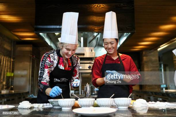 Katerina Siniakova of Czech Republic and Xinyun Han of China attend a function to cook Chinese sweet dumplings during 2018 WTA Shenzhen Open at...