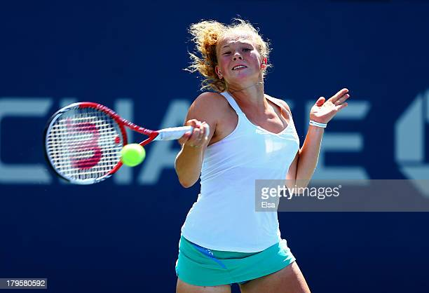 Katerina Siniakova of Czech Republic plays a forehand during her girls' singles third round match against Maria Marfutina of Russia on Day Eleven of...