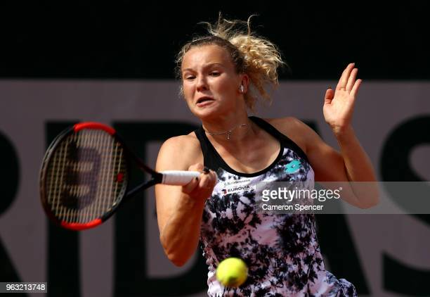 Katerina Siniakova of Czech Republic plays a forehand during the ladies singles first round match against Victoria Azarenka of Belarus during day two...