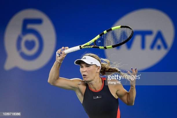Katerina Siniakova of Czech Republic returns a shot against Caroline Garcia of France during 2018 Wuhan Open at Optics Valley International Tennis...