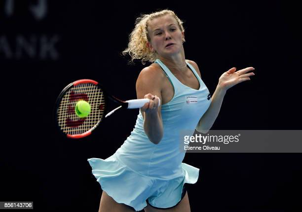 Katerina Siniakova of Czech Republic returns a shot against Samantha Stosur of Australia during their first round match on day two of the 2017 China...
